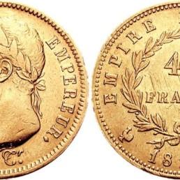 Création de la Banque de France par Napoléon : pièce en or frappée sous le Premier Empire et présentant la tête laurée de Napoléon Ier.